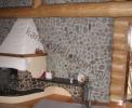 Wnętrza domów z bali - Kominki